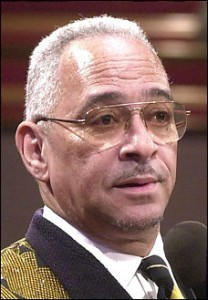 Rev. Jeremiah Wright gives words of comfort to family and mourners at a funeral service for Roebuck Staples at Trinity United Church of Christ in Chicago, in this Dec. 23, 2000 file photo. U.S. Democratic presidential hopeful, Sen. Barack Obama, D-Ill., on Friday, March 14, 2008, denounced inflammatory remarks from his pastor, who has railed against the United States and accused its leaders of bringing on the Sept. 11 attacks by spreading terrorism. (AP Photo/Chicago Sun-Times, Brian Jackson) **CHICAGO OUT, MAGS OUT**
