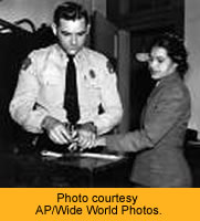 """Rosa Parks being arrested for refusing to give up her seat in the """"whites only"""" bus section."""