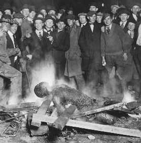 """Jim Crow Benefactors at work, proudly lynching, and over an assumed crime which often included a """"stare""""."""